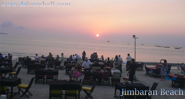 sunset and dinner with seafood at jimbaran beach